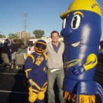 Rocket mascot visits the tailgaters  near the stadium.